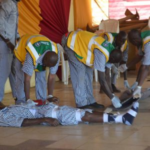 prisoners demonstrating first aid skills at a graduation ceremony
